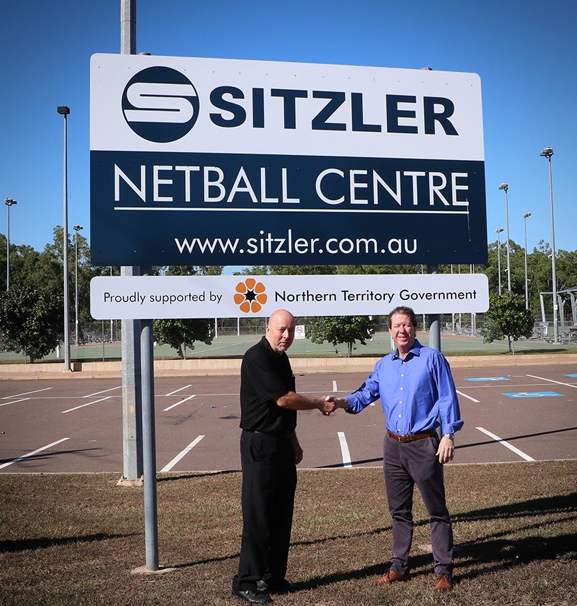 Sitzler Director Michael Sitzler and NNT Executive Officer Ian Harkness seal the deal on a three year partnership between Netball NT and Sitzler.